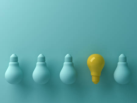 Think different concept , One yellow light bulb standing out from the unlit green incandescent lightbulbs with reflection and shadow , leadership and different creative idea concept. 3D rendering. Stock Photo