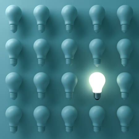 One glowing light bulb standing out from the unlit incandescent bulbs on green background with reflection , individuality and different creative business bright idea concepts . 3D rendering.