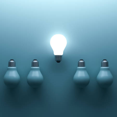 One glowing light bulb standing out from the unlit incandescent bulbs on cyan background with shadow and reflection , individuality and different creative idea concepts . 3D rendering.