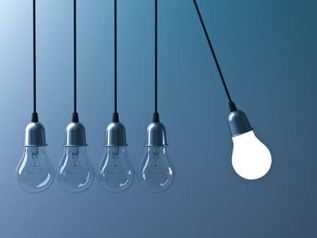 idea: One hanging light bulb glowing different and stand out from unlit incandescent bulbs like newtons cradle on dark cyan background, leadership and different business creative idea concept. 3D rendering. Stock Photo