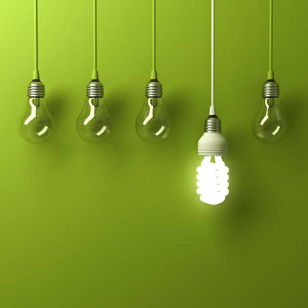 One hanging energy saving light bulb glowing different standing out from unlit incandescent bulbs with reflection on green background, leadership and different creative idea concept. 3D rendering. Stockfoto