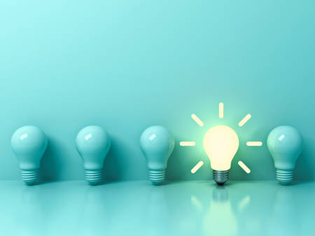 One glowing idea bulb standing out from unlit incandescent bulbs on light green pastel color background with reflection and shadow , individuality and different creative idea concepts . 3D rendering.
