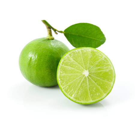 Green lemons or lime with leaf isolated on white background