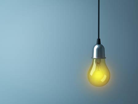 Hanging Light bulb glowing on dark cyan background . 3D rendering.