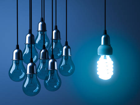 One hanging eco energy saving light bulb glowing and standing out from unlit incandescent bulbs on dark blue background , leadership and different creative idea concept. 3D rendering. 스톡 콘텐츠