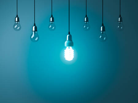 One hanging energy saving light bulb glowing stand out from unlit incandescent bulbs with reflection on dark cyan background , leadership and different creative idea concept. 3D rendering. Banque d'images