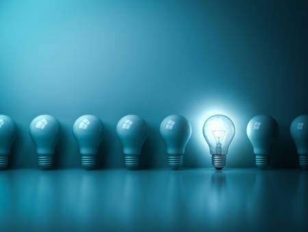 One glowing idea light bulb standing out from unlit incandescent bulbs on dark green pastel color background with reflection and shadow , individuality and different creative idea concepts . 3D rendering.