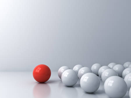 Leadership concept one red sphere leading whites over white room background with reflections and shadows 3D rendering