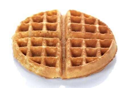 waffles: un waffle ronda sobre un fondo blanco Foto de archivo