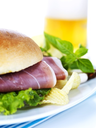 sandwish: a prosciutto sandwish and a glass of beer Stock Photo