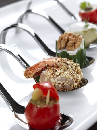 five different appetizers served in a modern style photo