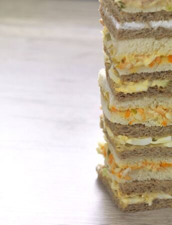 a stack of club sandwiches in different flavors