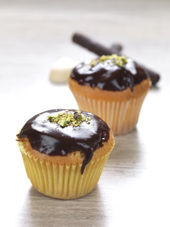 two muffins with a chocolate topping photo