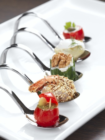 canape: five different appetizers served in a modern style
