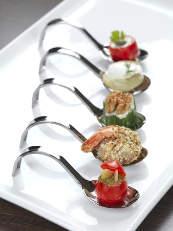 catering food: five different appetizers served in a modern style