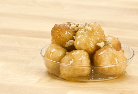 loukoumades,a greek dessert, served in a glass bowl Reklamní fotografie