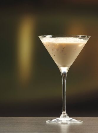 woman with ice cream: an irish cream liquor in a martini glass Stock Photo