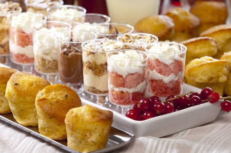 cheese and olive cupcakes, variety of desserts and homemade lemonade and cherry drink, served for a festive buffet