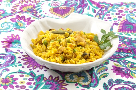 paella-fried spicy rice with chicken, seafood and vegetables photo