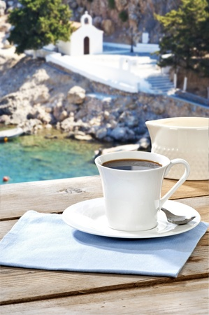 black coffee served on an aged table at a Greek island