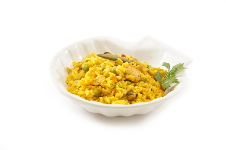 traditional spanish plate  paella  made of rice, spices, seafood, chicken, vegetables e t c
