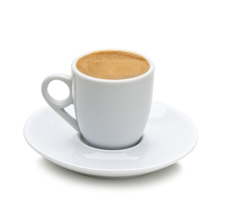 coffee grounds: greek coffee in a white cup isolated on a white background path included