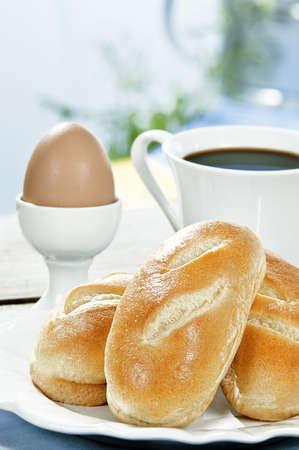 includes: breakfast includes brioche,egg and coffee  Stock Photo