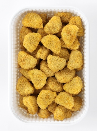 butcher shop: chicken nuggets in a plastic box for a meat market Stock Photo