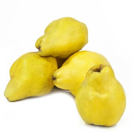 quinces: five quinces on a white background