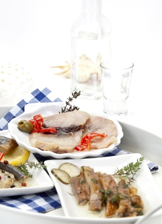 assortment of smoked fish and ouzo vertical