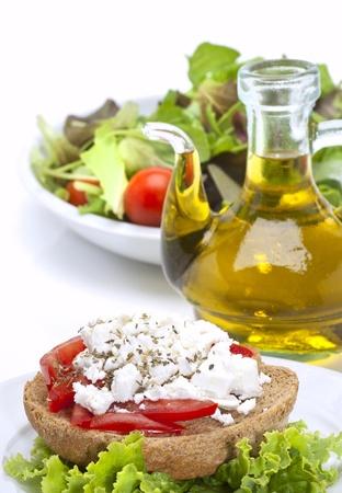 cretan recipe dakos , green salad and olive oil vertical  Standard-Bild