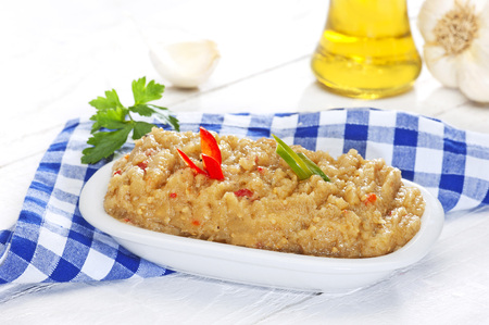 a traditional greek recipe made of mashed eggplants, red bell pepper garlic and olive oil