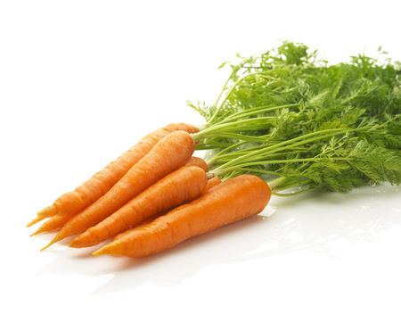 a bunch of fresh carrots isolated on a white background