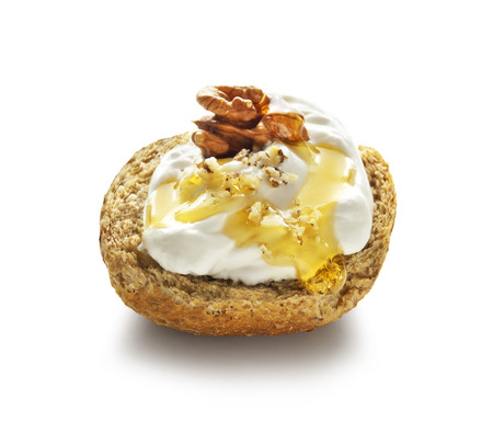 barley rusk called dakos ,topped with yogurt, honey and nuts Banco de Imagens