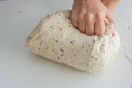 Man kneading a large dough for homemade bread in quarantine