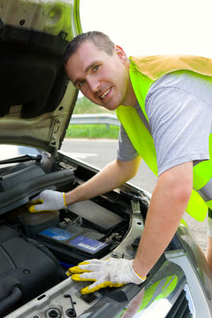 Man mechanic repairing his car on the road Stock Photo - 4097457