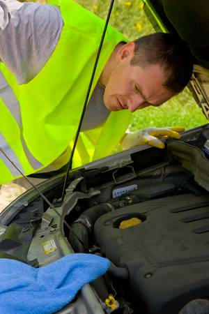 Man checking engine in a car Stock Photo - 4097432
