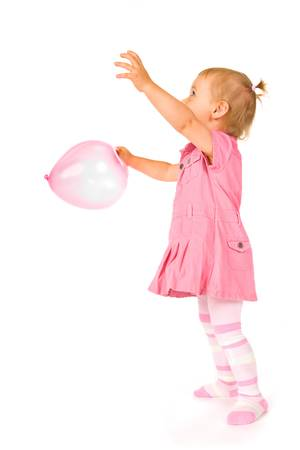 reaching: Cute happy baby girl with ballon