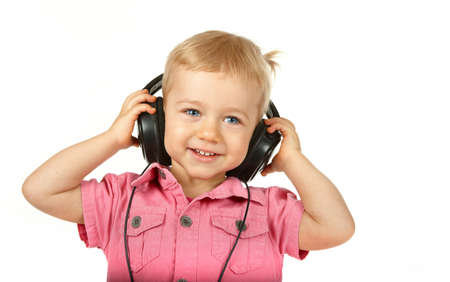 Portrait of young baby girl listening music via phones photo