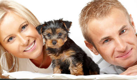 Happy couple with a funny puppy of Yorkshire Terrier Stock Photo - 4152972