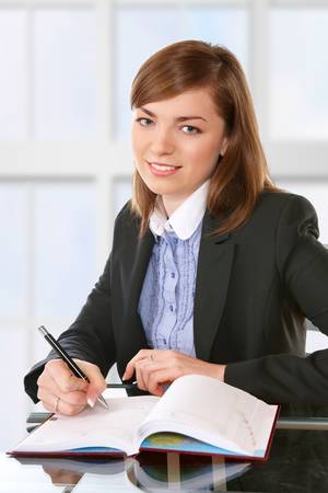 Woman in office or school or home working with papers Stock Photo - 4152949