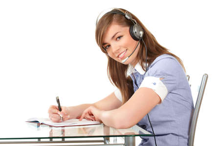 Smiling woman in headset working in office on a white background photo