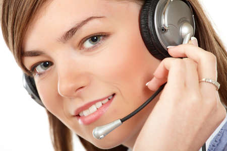 Close-up face of smiling woman in headphones on a white background photo