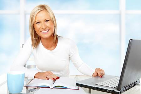 Beautiful businesswoman working or studying with laptop Stock Photo