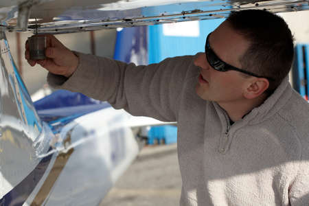 inspection: Pilot doing preflight checking in his plane Stock Photo
