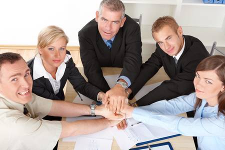 Business group at the meeting, hands put toghether