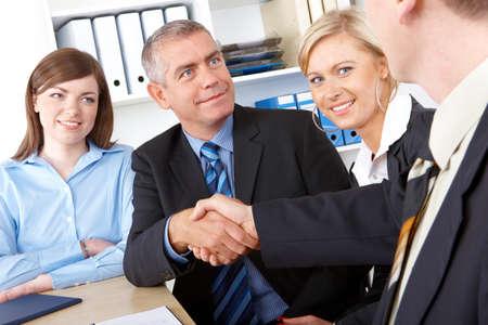 Business people make a deal, handshake