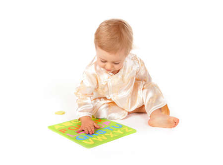Cute baby learning alphabet letters photo