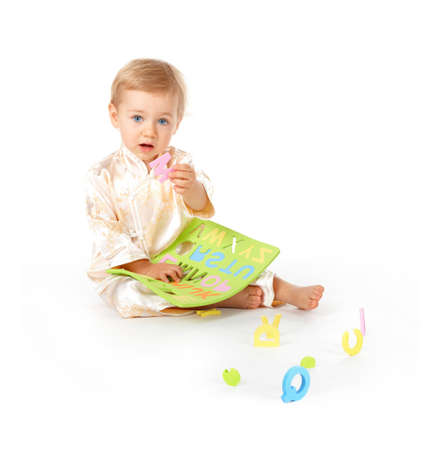 Cute baby learning alphabet letters; showing the M photo