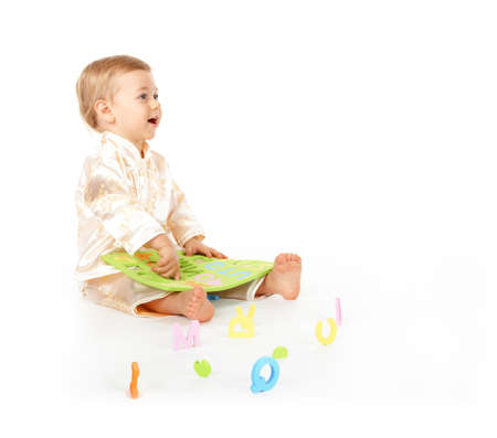 Happy cute baby learning alphabet letters photo